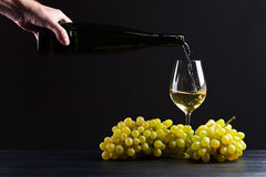 Wine being poured into a wineglass Royalty Free Stock Images