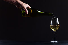 Wine being poured into a wineglass Stock Photography