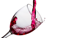 Wine being pouring into a glass closeup,. Wine being pouring into a glass closeup with splashing, on white background, with clipping path stock images