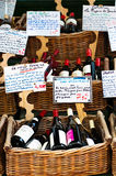 Wine being sold in the street. Baskets of red wine, which make France romantic, were being sold in a street market in Paris Stock Photos