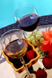 Wine and berry Stock Photos
