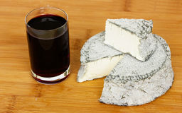 Wine and black cheese Stock Photography