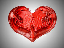 Wine or blood. Red liquid heart shape. Over grey background Stock Image