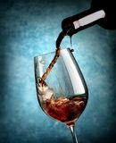 Wine on blue background Royalty Free Stock Photo