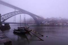 Wine boats and bridge in the fog. Wine boats in the fog, Porto, Portugal Stock Images