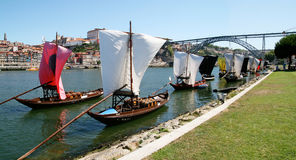 Wine Boats in Porto. Boats carrying wine docked after arrival, with sails furled, on the banks of the Douro River in Porto, Portugal Royalty Free Stock Photos