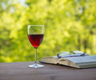 Wine book and glasses in the garden on Stock Image