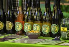 Wine Booth at Farmers Market. Portland,Oregon,USA - September 20, 2014:  Wine bottles with labels displayed for tasting at a booth in Portland, Oregon`s, South Stock Image