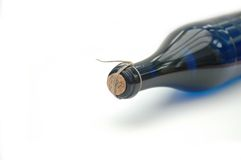 Wine Bottle. Blue wine bottle isolated on a white background, taken in a studio Royalty Free Stock Image