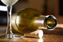 Wine bottle. Empty bottle of  wine on its side with cork and glass next to it Stock Photography