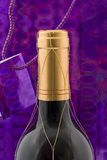 Wine bottle. A wine bottle with gift wrapping and tag Royalty Free Stock Image