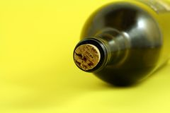 Wine bottle. With yellow background Stock Image