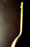 Wine bottle against a black background Stock Photography