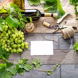Wine Bottle And Grapes On Wooden Table. Top View With Space For Royalty Free Stock Photos