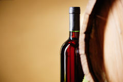 Wine bottle and barrel Royalty Free Stock Images