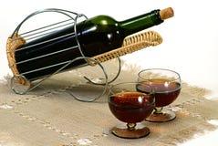 Wine bottle in basket stock photography
