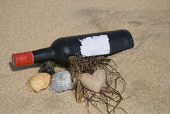 Wine bottle on beach Royalty Free Stock Images