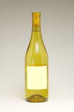 Wine Bottle with blank label. White wine bottle with blank label royalty free stock photography