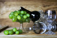 Wine bottle book and glass grape Stock Images