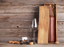 Wine bottle in box and glasses Royalty Free Stock Images