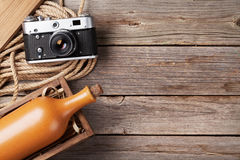 Wine bottle in box and vintage camera Royalty Free Stock Photos