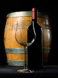 Wine bottle and cask. Wine bottle with cask and glass on black background Stock Images
