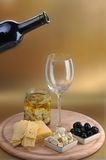 Wine bottle and cheese Royalty Free Stock Image