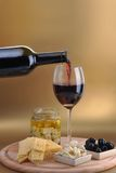 Wine bottle and cheese Stock Photography