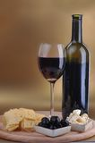 Wine bottle and cheese Stock Images