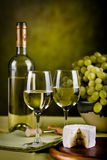 Wine bottle and cheese stock photo