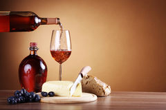 Wine in bottle and cheese Royalty Free Stock Images