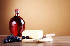 Wine in bottle and cheese Royalty Free Stock Photos