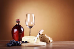 Wine in bottle and cheese Stock Images