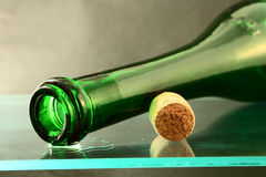 Wine bottle with cork. Empty wine bottle with cork on glass stock images