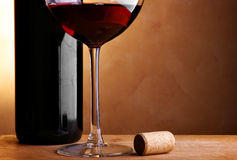 Wine bottle, cork and glass Stock Images