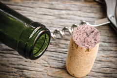 Wine Bottle and Cork with Red Wine and corkscrew Stock Photography