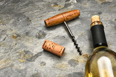 Wine Bottle Cork Screw on Slate. Top view of a wine bottle and cork screw on a slate surface Stock Image
