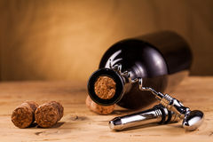 Wine bottle corks and corkscrew on table Stock Photos