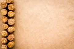 Wine bottle corks pattern on craft paper background top view copyspace. New Year celebration concept.  Stock Photo