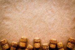Wine bottle corks pattern on craft paper background top view copyspace. New Year celebration concept Royalty Free Stock Photo