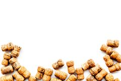 Wine bottle corks pattern on white background top view copyspace. New Year celebration concept Stock Photos