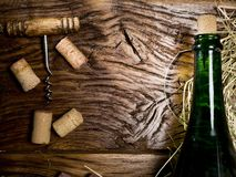 Wine bottle and corks on wooden table. Royalty Free Stock Photography