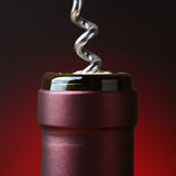 Wine Bottle and Corkscrew Closeup Stock Image