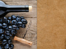 Wine bottle, corkscrew and grape Stock Image