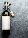Wine bottle and corkscrew. Royalty Free Stock Image