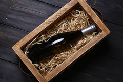 Wine bottle in a crate Stock Photography