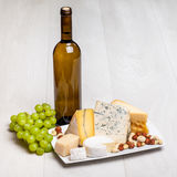 Wine bottle and different kinds of cheese Royalty Free Stock Photography