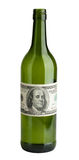 Wine bottle with a dollar bills Royalty Free Stock Image