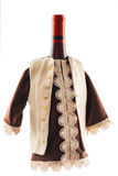 Wine bottle dressed in European folklore boyar costume Royalty Free Stock Photos