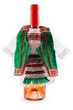 Wine bottle dressed in European folklore costume Royalty Free Stock Photography